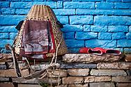 A porters basket and boots at Annapurna basecamp, Annapurna Sanctuary, Nepal