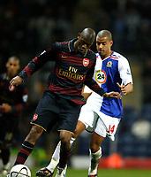 Photo: Paul Greenwood/Sportsbeat Images.<br />Blackburn Rovers v Arsenal. Carling Cup, Quarter Final. 18/12/2007.<br />Arsenal's Abou Diaby (L) holds off Steven Reid