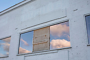 Reflections of blue sky and clouds in a window on 12th January 2020 in London, England, United Kingdom.