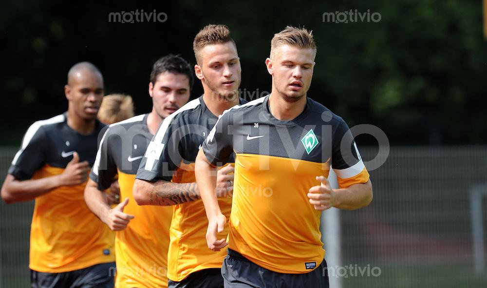 FUSSBALL   1. BUNDESLIGA   SAISON 2012/2013  Trainingsauftakt SV Werder Bremen am 05.07.2012 Naldo, Denni Avdic, Marko Arnautovic und Florian Hartherz (v.l.)