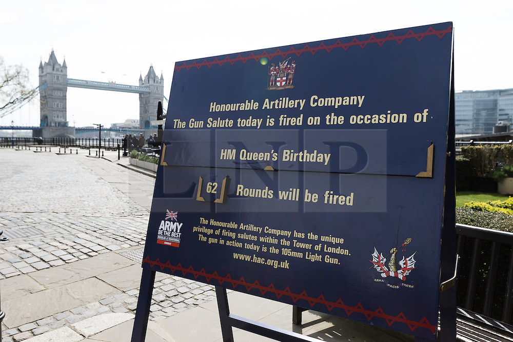 © Licensed to London News Pictures. 21/04/2016. London, UK. A sign notifying that the Honourable Artillery Company (HAC) will fire a 62 round gun salute at The Tower of London, near Tower Bridge to mark the 90th birthday of Great Britain's Queen Elizabeth II. A Royal Salute normally comprises 21 guns, but is increased to 41 if fired from a Royal Park or Residence and uniquely, at The Tower of London, a total of 62rounds are fired on Royal anniversaries, including an additional 21 guns for the citizens of the City of London to show loyalty to the Monarch.  Photo credit : Vickie Flores/LNP