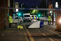 © Licensed to London News Pictures. 26/07/2020. Manchester, UK. The scene on Henbury Street, I lps Side, where a 17 year old boy was stabbed to death and three others stabbed causing injuries, this evening. Photo credit: Joel Goodman/LNP