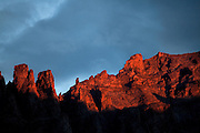 The towers and buttes of the Lone Eagle Cirque are touched by the final rays of sunlight, Indian Peaks Wilderness area, Colorado.