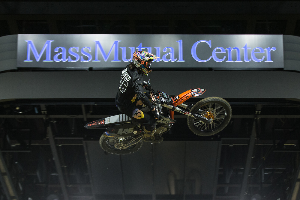 A motocross rider gets lots of air during a performance.