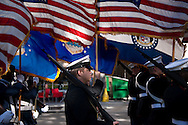 """9 NOV. 2013 -- ST. LOUIS -- Nathan Aubuchon (center), a member of the Naval Junior ROTC at Cleveland NJROTC High School, joins other flag bearers for the """"Massing of the Colors"""" to start the St. Louis Veteran's Day Parade in downtown St. Louis Saturday, Nov. 9, 2013. The parade started near the Soldiers' Memorial at Tucker and Chestnut and wound to its conclusion neat Market and 20th streets. Photo © copyright 2013 Sid Hastings."""