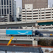 An Amazon Prime delivery truck is seen on an empty Interstate 4 exit at rush hour during the Coronavirus (Covid-19) outbreak on Tuesday, April 15, 2020 in Orlando, Florida. (Alex Menendez via AP)