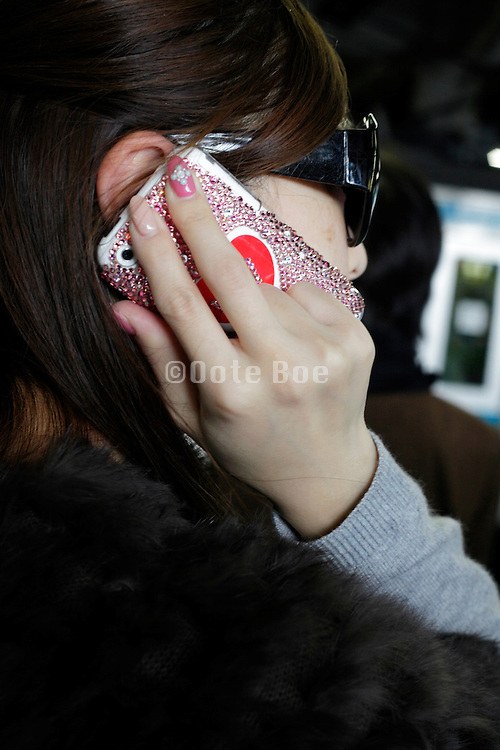 young adult woman talking on a mobile phone with ornamental design
