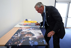Gary Player signs photographs from his early career for the R&A after a press conference on preview day four of The Open Championship 2018 at Carnoustie Golf Links, Angus.