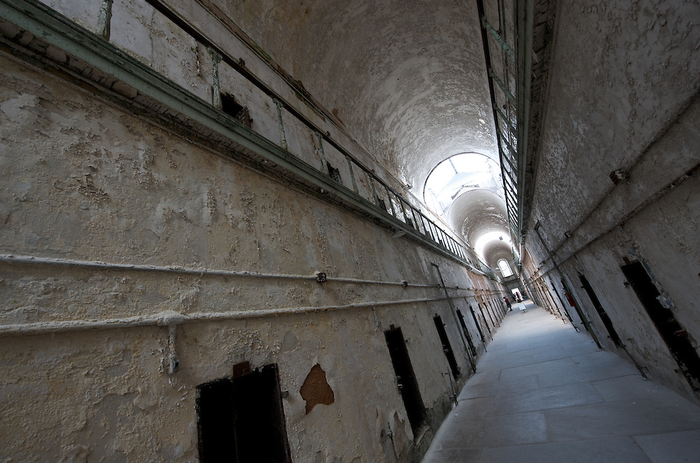 "Abandoned cell block at Eastern State Penitentiary, Philadelphia, PA (US).  Opened in 1829, and dubbed the ""Pennsylvania System"" or Separate system, originated and encouraged solitary confinement as a form of rehabilitation. The prison was closed and abandoned in 1971, now operates as a museum and historic site."