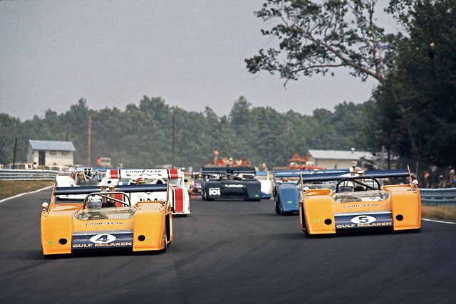 """McLaren M20 team mates Peter Revson (on pole in no. 4) and Denny Hulme (race winner in no. 5) pace the start of the 1972 Watkins Glen Can-Am; this would be the last series victory for the once-dominant """"Kiwi"""" team, and in fact the last race the pair would start from the front row; PHOTO BY Pete Lyons 1972 / www.petelyons.com"""