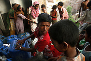 A group of slum dwellers on the hills surrounding the tannery area of Jajmau are busy collecting fresh water being provided to the colony daily by the government in Kanpur, Uttar Pradesh. The inhabitants are complaining that too little water is provided for the large population of the area, while in case of power cuts, a very common event in Kanpur, the pumping station can shut down completely for days at the time. Rows and arguments over water collection here are an unfortunate daily reality.