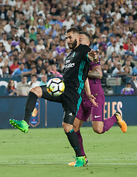 July 26, 2017 - Los Angeles, California, U.S - Karim Benzema #9 of Real Madrid goes for the ball against a Manchester City defender during their International Champions Cup game at the Los Angeles memorial Coliseum in Los Angeles, California on Wednesday July 26, 2017. Manchester City defeats Real Madrid, 4-1. (Credit Image: © Prensa Internacional via ZUMA Wire)