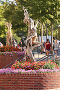 Reminiscence by sculpture Tuan along Main Street in downtown Greenville, South Carolina.