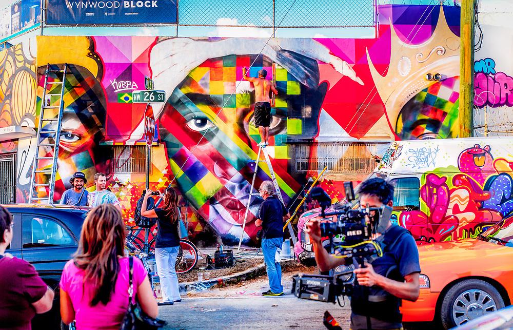 Brazilian street artist Kobra paints a mural portrait of rapper Tupac Shakur in Miami's booming Wynwood neighborhood during Miami Art Week 2013