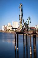 cranes and loading station in the Rhine harbor in the district Deutz, in the background the Ellmill, Cologne, Germany.<br /> <br /> Verladekraene und Verladestation im Deutzer Hafen, im Hintergrund die Ellmuehle, Koeln, Deutschland.