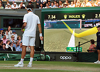 Tennis - 2019 Wimbledon Championships - Week Two, Friday (Day Eleven)<br /> <br /> Men's Singles, Semi-Final: Rafael Nadal (ESP) v Roger Federer (SUI)<br /> <br /> Roger Federer watches Nadla's shot go out with Hawkeye on Centre Court.<br /> <br /> COLORSPORT/ANDREW COWIE