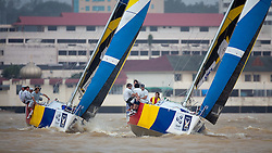 Damien Lehl (FRA) leading Francesco Bruni (ITA) to the top mark. Monsoon Cup 2009. Kuala Terengganu, Malaysia. 3 December 2009. Photo: Sander van der Borch / Subzero Images