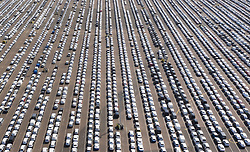 VIDEO AVAILABLE. https://we.tl/t-Zy8FST8cRA © Licensed to London News Pictures. 17/04/2020. Sheerness, UK. Imported new cars and vans fill Sheerness docks in Kent. New car sales are reported to have dropped by 44% as the effects of the coronavirus lockdown take hold. The government have announced that lockdown will continue for another three weeks. The public have been told they can only leave their homes when absolutely essential, in an attempt to fight the spread of coronavirus COVID-19 disease. Photo credit: Peter Macdiarmid/LNP