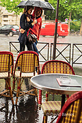 France, Paris, Couple walking in the rain.