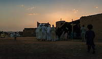 Men and women from a Sudanese Berber community in Merzouga perform a traditional dance during a four day wedding celebration.