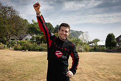 © Licensed to London News Pictures. 04/08/2019. Dover, UK. French inventor Franky Zapata celbrates at St Margarets Bay near Dover after crossing the English Channel on his jet-powered hoverboard. He is hoping to make the 35km crossing with a refueling stop mid channel to reach the English coast after setting off at 6am French time. Photo credit: Peter Macdiarmid/LNP