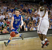 Brett Comer (0) of the Florida Gulf Coast University Eagles brings the ball up the court against the University of Florida Gators during the NCAA South Regionals at Cowboys Stadium in Arlington on Friday, March 29, 2013. (Cooper Neill/The Dallas Morning News)