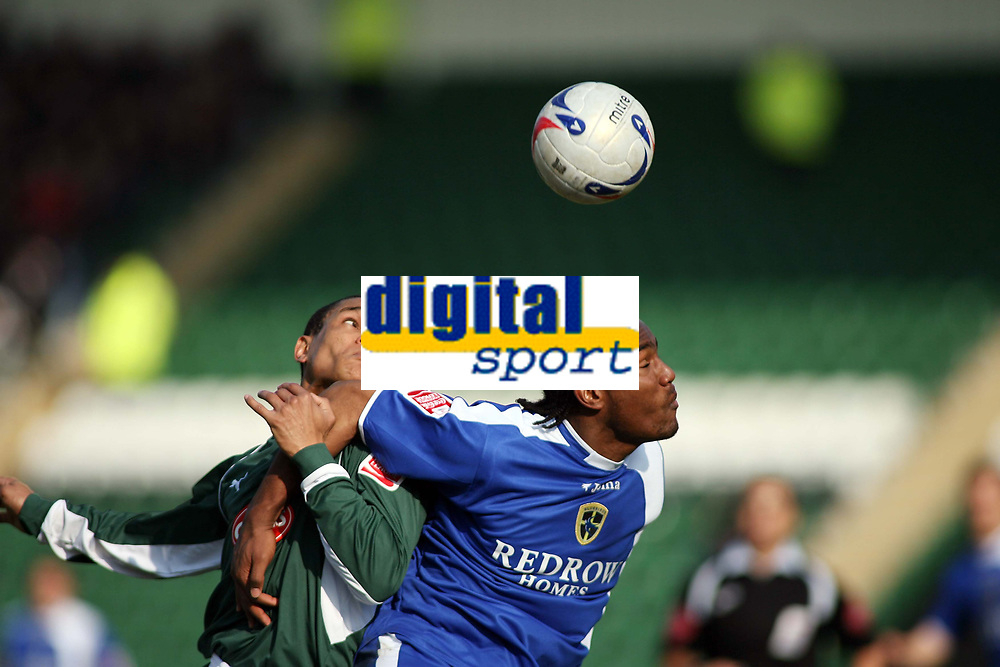 Mathias Kouo-Doumbe of PLymouth clashes with Cardiffs Cameron Jerome<br /> <br /> Photo: Richard Eaton.<br /> <br /> Plymouth Argyle v Cardiff City. Coca Cola Championship. 18/03/2006.