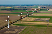 Nederland, Oostelijk Flevoland, Gemeente Dronten, 03-10-2010; Omgeving Biddinghuizen, .windmolens en akkers, windmolenpark. Lelystad aan de horizon..Windmills and fields, wind farm..luchtfoto (toeslag), aerial photo (additional fee required).foto/photo Siebe Swart