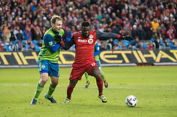 December 9, 2017 - Toronto, Ontario, Canada - Toronto FC forward JOZY ALTIDORE (17) fights for the ball against Seattle Sounders defender CHAD MARSHALL (14) during the MLS Cup championship match at BMO Field in Toronto, Canada.  Toronto FC defeats Seattle Sounders 2 to 0. (Credit Image: © Mark Smith via ZUMA Wire)
