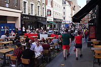 people out and about in Soho London Photo by Roger Alarcon