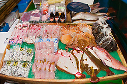 various fresh sea food for sale at wholesale shop, Tsukiji Fish Market or Tokyo Metropolitan Central Wholesale Market, the world's largest fish market, hadling over 2, 500 tons and over 400 different kind of fresh sea food per day