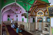 Prayers at mosque near the sacred Ajmer Sharif or Dargah Sharif, a sufi shrine (dargah) of the revered sufi saint, Moinuddin Chishti. Ajmer, Rajasthan.