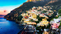 """""""Positano dawn awakening from a peaceful sleep""""…<br /> <br /> This is a panoramic of two horizontal images combined to capture a more extensive view of Positano at dawn. There was only one occasion that I was really able to pre-plan taking photos at sunrise and that was during the last day of three in Positano.  It takes much planning, logistics, and familiarity to figure the best locations and the proper angles and positions of the sun.  My third morning was ideal and fortuitous as it began raining about 10:00 am which gave me perfect clouds for sunrise, finally ending with a very cold wind just in time for sunset.  This image is one of the rare photos of a slumbering Positano in the dewing morning around 6:35 am at the end of May….the beginning of peak tourist season.  By 8:00 am, this tiny seaside village is bustling with tourists and shop owners, and restaurateurs trying to satisfy every need.  All in all, Positano was by far the plushest of all the locations I visited in Italy, and I was blessed to witness everything in full bloom."""