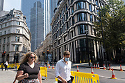 As Britain enters a period of deep recession, the streets are very quiet in the City of London with just a few people interacting with social distancing temporary road layouts marked out with rows of yellow barriers on 12th August 2020 in London, United Kingdom. The Office for National Statistics / ONS has announced that gross domestic product / GDP, the widest gauge of economic health, fell by 20.4% in the second quarter of the year, compared with the previous quarter. This is the biggest decline since records began. The result is that Britain has officially entered recession, as the UK economy shrank more than any other major economy during the coronavirus outbreak.