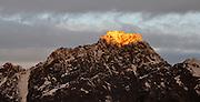 New Zealand southern Alps glowing sunlight on a mountain peak