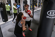 WASHINGTON, DC - NOVEMBER 14: Vermecia Alsop, 35, (center) of Washington, DC, laughs with her coach, Monica Jones during a boxing conditioning class at NUBOXX on Wednesday, November 14, 2018 in Washington, DC. Once a sweaty, gritty environment of men, the recent trend of fitness boxing is now all about brightly-lit studios and fresh millennial faces working the heavy or speed bag. (Photo by Pete Marovich For The Washington Post)