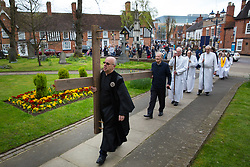© Licensed to London News Pictures. 14/4/2016. Solihull, West Midlands, UK.  Easter Walk of Witness taking place in Solihull. Pictured, the procession makes it's way in to St Alphege Church. All the churches of Solihull coming together. Starting at St Augustine's Church around two hundred people walked behind a wooden cross into Mell Square for readings and prayers before continuing the walk to St Alphege Church.  Photo credit: Dave Warren/LNP