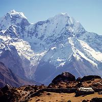 Kengtega and Thamserku peaks with yak pastures in the foreground, Khumbu region, Nepal 1980