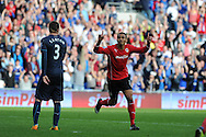 Cardiff city's Peter Odemwingie © celebrates after he scores his sides  goal to make it 1-2. Barclays Premier League match, Cardiff city v Newcastle Utd  at the Cardiff city stadium in Cardiff, South Wales on Saturday 5th Oct 2013. pic by Andrew Orchard, Andrew Orchard sports photography,