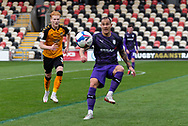 Tranmere Rover's Kieron Morris (7) under pressure from Newport County's Ryan Haynes (3) during the EFL Sky Bet League 2 match between Newport County and Tranmere Rovers at Rodney Parade, Newport, Wales on 17 October 2020.