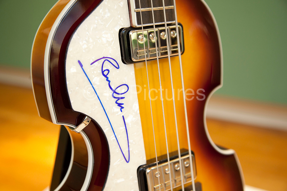 London, UK. Friday 23rd November 2012. Christies auction house showcasing memorabilia from every decade of the past century of popular culture from the industries of film and music. Hofner 500/1 violin bass guitar signed by Paul McCartney.