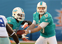 August 23rd, 2014, Miami Dolphins quarterback Ryan Tannehill (17) hands the football to Miami Dolphins running back Lamar Miller (26) during a game between the Miami Dolphins and the Dallas Cowboys at Sun Life Stadium in Miami Garden, FL NFL American Football Herren USA AUG 23 Preseason - Cowboys at Dolphins PUBLICATIONxINxGERxSUIxAUTxHUNxRUSxSWExNORxONLY Icon140823004<br />