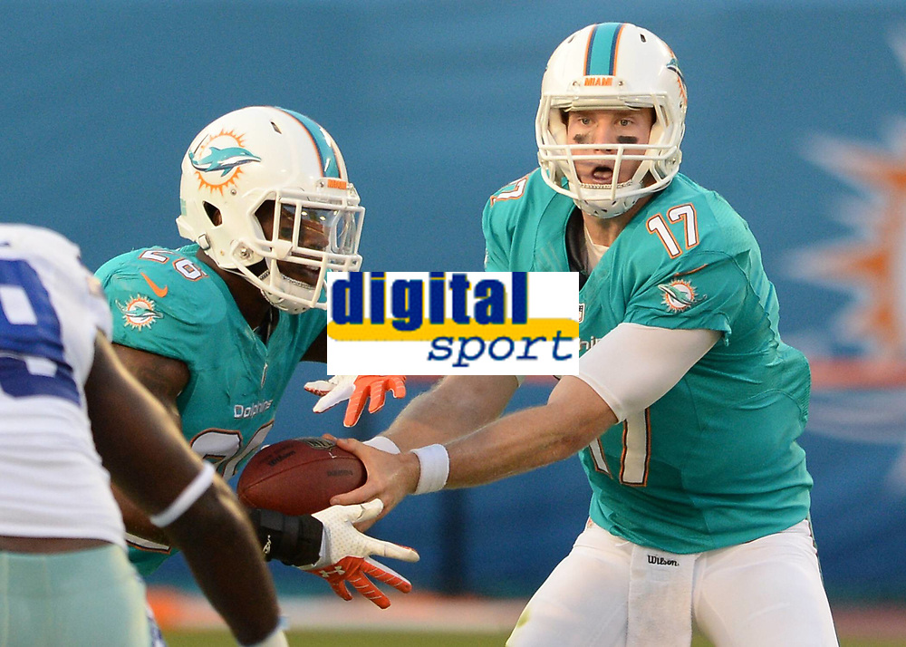 August 23rd, 2014, Miami Dolphins quarterback Ryan Tannehill (17) hands the football to Miami Dolphins running back Lamar Miller (26) during a game between the Miami Dolphins and the Dallas Cowboys at Sun Life Stadium in Miami Garden, FL NFL American Football Herren USA AUG 23 Preseason - Cowboys at Dolphins PUBLICATIONxINxGERxSUIxAUTxHUNxRUSxSWExNORxONLY Icon140823004<br /> <br /> August 23rd 2014 Miami Dolphins Quarterback Ryan Fir Hill 17 Hands The Football to Miami Dolphins Running Back Lamar Miller 26 during A Game between The Miami Dolphins and The Dallas Cowboys AT Sun Life Stage in Miami Garden Fl NFL American Football men USA Aug 23 Preseason Cowboys AT Dolphins PUBLICATIONxINxGERxSUIxAUTxHUNxRUSxSWExNORxONLY