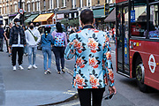 Colourful floral flower print suit jacket on 10th August 2021 in London, United Kingdom. London is a place where outlandish and creative fashion is seen everywhere, with people very much happy to exercise their own individual style.