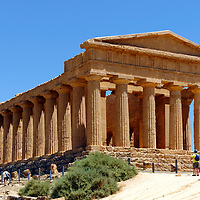 Agrigento. Sicily. Italy.  View of the front of the magnificent Greek Doric Temple of Concord or Tempio della Concordia at the Valley of the Temples. Dating from around 430 BC, the Temple has all of its original 34 local shell limestone columns still standing in a peripteral hexastyle plan of 6 by 13 columns, only the ceiling and roof are missing.