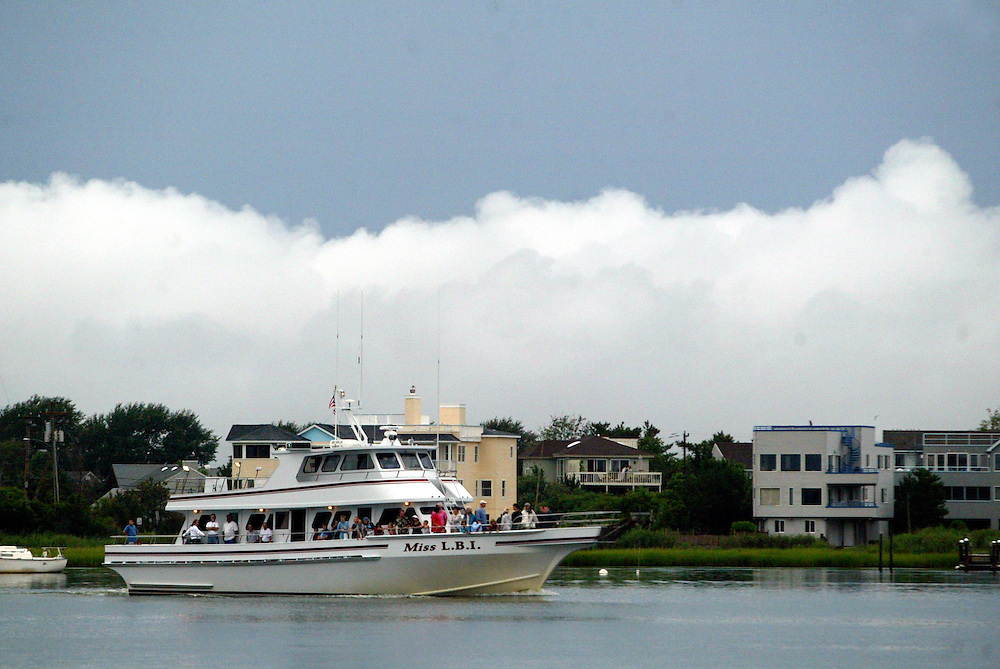 (DAYIN) Barnegat 8/7/1002 Miss LBI party boat returns to his dock after having completed a private charter aboard his boat.  Michael J. Treola Staff Photographer....MJT