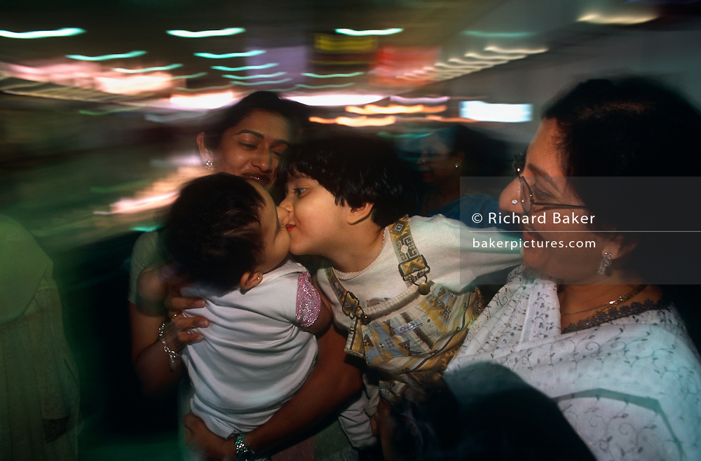 Young realitves greet each other after an arrived flight at the Gulf state of Bahrain's international airport.