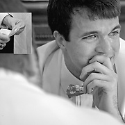 A groom cries after reading a letter from his bride before their wedding ceremony in Columbia, S.C. ©Travis Bell Photography