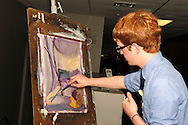 WSU sophomore Micah Zavacky creates a painting while patrons bid on it and other objects in a silent auction during the 13th Annual ArtsGala at Wright State University's Creative Arts Center, Saturday, March 31, 2012.