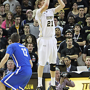 Central Florida forward P.J. Gaynor (21) shoots past Memphis guard/forward Drew Barham (12) during a Conference USA NCAA basketball game between the Memphis Tigers and the Central Florida Knights at the UCF Arena on February 9, 2011 in Orlando, Florida. Memphis won the game 63-62. (AP Photo: Alex Menendez)